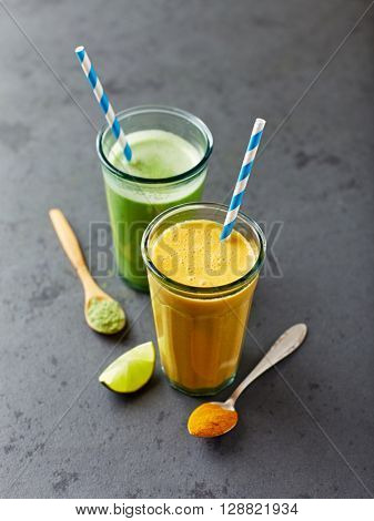 Glass of orange and green smoothie