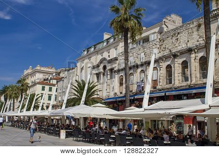 SPLIT, CROATIA - AUGUST 31, 2014: Tourists on the Riva (sea promenade) on a summer day. Split is popular touristic coastal destination in Croatia.