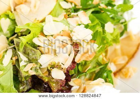 Pear salad with goat cheese and almonds, Macro. Photo can be used as a whole background,