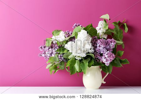 Blooming Lilac Flowers In The Vase On Pink Background