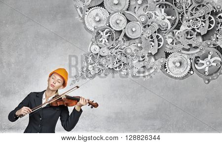 Builder woman play violin