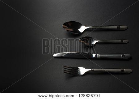 set of kitchen tools on dark table