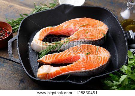 Steak Raw Salmon On A Grill Pan