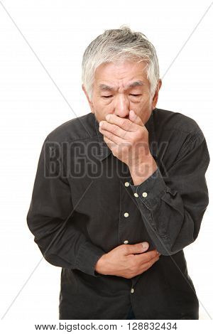 portrait of senior Japanese man feels like vomiting