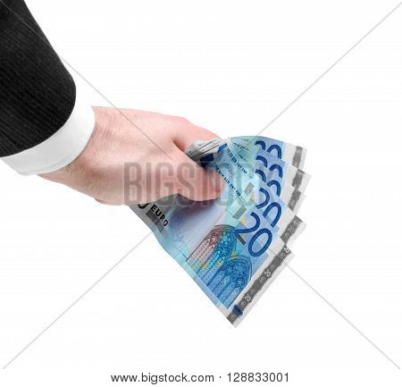 Businessman's hand holding a stack of twenty euro notes isolated on white background.