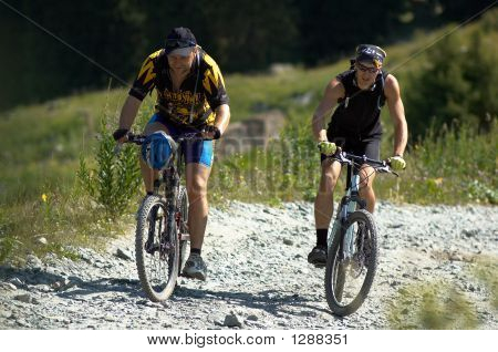 Two Bikers On High Mountain Road