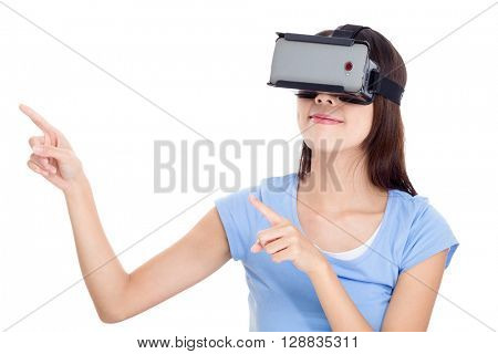Woman wearing vr device and finger point up