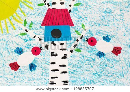 Color applique picture with birds flying towards the birdhouse on a birch tree on a Sunny day.