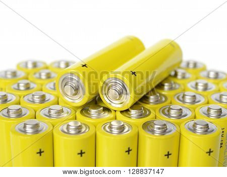 Group of yellow batteries isolated on a white background.