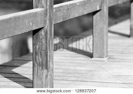 design of the wooden floor or platform with a handrail closeup and blank space of monochrome tone