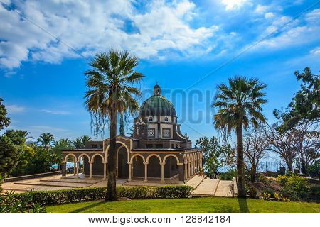 Church Sermon on the Mount - Mount of Beatitudes. Beautiful park of cypress and palm trees. Sea of Galilee, Israel