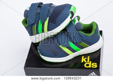 Varna Bulgaria - APRIL 9 2016 : ADIDAS SNICE 4 CF children shoe. Isolated on white. Product shot. Adidas is a German corporation that designs and manufactures sports shoes clothing and accessories