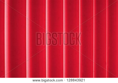 A red color drape or background material