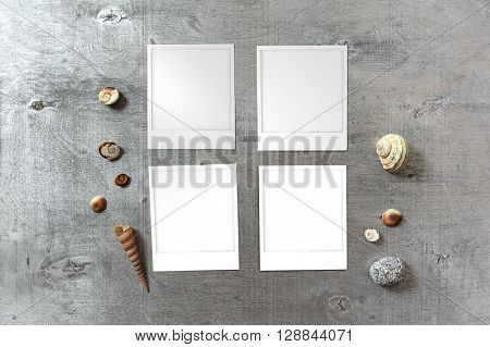Snapshots templates arranged on rustic wooden background with seashells around with copy space top view