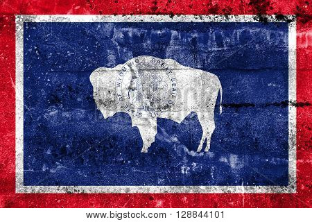 Flag Of Wyoming State, Painted On Dirty Wall. Vintage And Old Look.