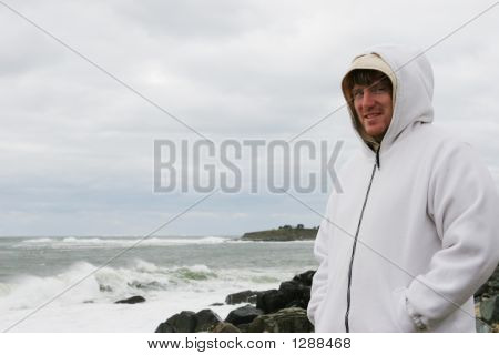 Man At The Beach On A Cold Day