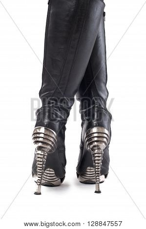 Woman boots. Closeup of female legs in high heel boots