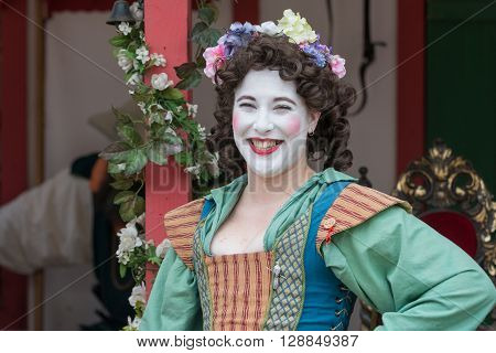 Young Woman With Painted Face And Medieval Costume