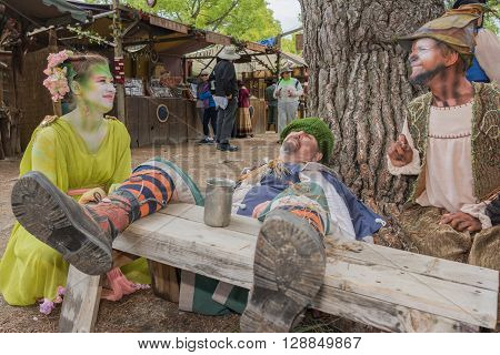 Man With Medieval Costume Lying Simulating Drunkenness