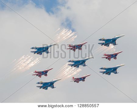 Moscow - May 7 2016: Nine of Su-27 and MiG-29 fired a salute and feyervek as part of a rhombus on Victory Day parade May 7 2016 Moscow Russia