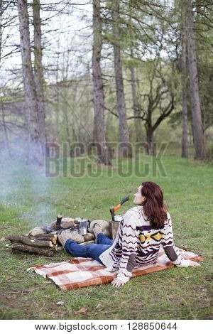 A Girl Sits By The Fire And Drink Coffee.