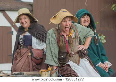 Women With Medieval Costumes Performing