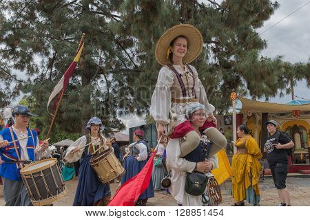 People In Medieval Costumes Playing And Singing