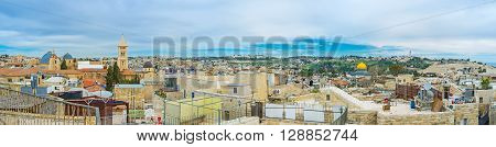Panorama covers the wide view from the dome of the Holy Sepulchre Church to the golden cupola of the Dome of the Rock and the Mount of Olives Jerusalem Israel.