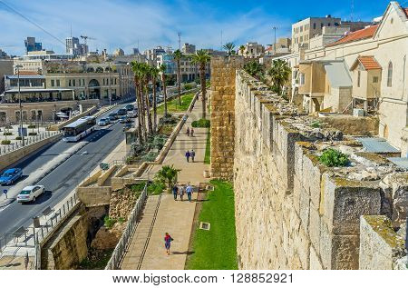 JERUSALEM ISRAEL - FEBRUARY 18 2016: The medieval ramparts separate the historical districts of the walled city from the modern neighborhoods on February 18 in Jerusalem.