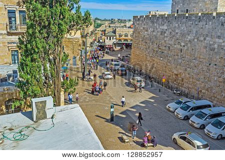JERUSALEM ISRAEL - FEBRUARY 18 2016: The pleasant walk on the ramparts of the old city on February 18 in Jerusalem.