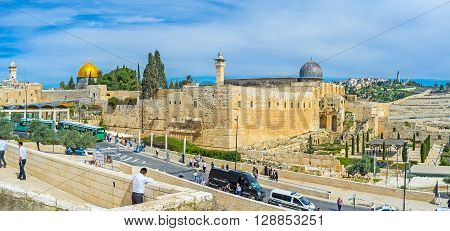 JERUSALEM ISRAEL - FEBRUARY 18 2016: The view on the Southern Wall of the Temple Mount architectural ensemble with the cupolas of Al-Aqsa Mosque and Dome of the Rock on February 18 in Jerusalem.