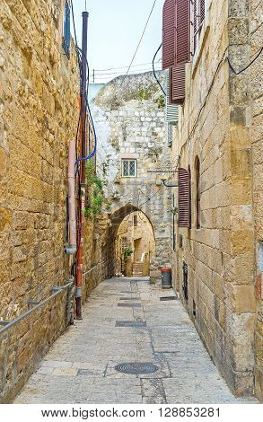 The old street with the arched passage in the Jewish Quarter of Jerusalem Israel.