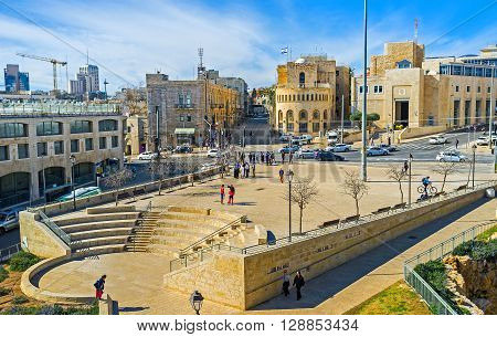 JERUSALEM ISRAEL - FEBRUARY 18 2016: The high city ramparts overlooks the modern Tsahal Square located adjacent to the New Gate and Mamilla Road on February 18 in Jerusalem.