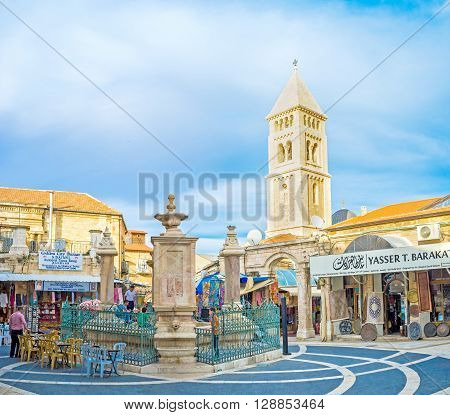 JERUSALEM ISRAEL - FEBRUARY 18 2016: The Muristan Square located adjacent to the Aftimos bazaar boasts the beautiful stone drinking fountains surrounded by cafes and stalls on February 18 in Jerusalem.