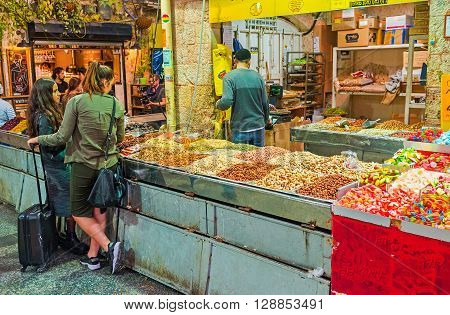 JERUSALEM ISRAEL - FEBRUARY 17 2016: The jelly candies nuts and sunflower seeds are popular snacks offering in Mahane Yehuda market on February 17 in Jerusalem.