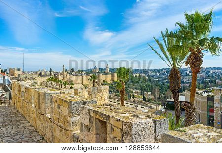 The medieval city walls nowadays serves as the tourist promenade overlooking the old quarters Israel.