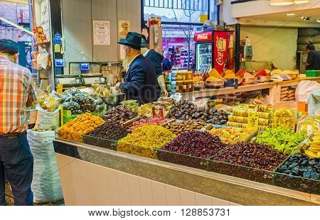 JERUSALEM ISRAEL - FEBRUARY 17 2016: The shop offers the dried fruits nuts and many types of raisins especially popular in the Middle East on February 17 in Jerusalem.