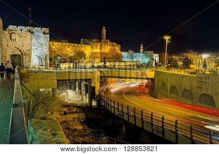 The David's fortress in the bright evening illumination with the Mamilla Road on the foreground Jerusalem Israel.