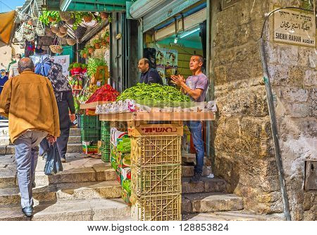 JERUSALEM ISRAEL - FEBRUARY 18 2016: The noisy merchants offers fresh fruits and vegetables in Bazaar at Damascus Gate on February 18 in Jerusalem.