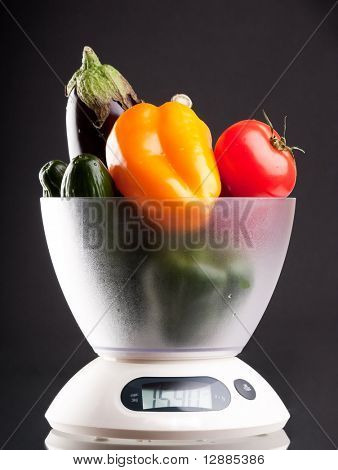 vegetables on the kitchen scale