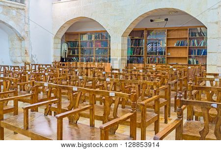 JERUSALEM ISRAEL - FEBRUARY 18 2016: The Eliyahu Hanavi synagogue with a lot of books in book shelves for study Four Sephardic Synagogues complex on February 18 in Jerusalem.