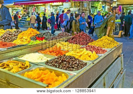 JERUSALEM ISRAEL - FEBRUARY 18 2016: The stall in Mahane Yehuda market offers different dried fruits on each taste on February 18 in Jerusalem.