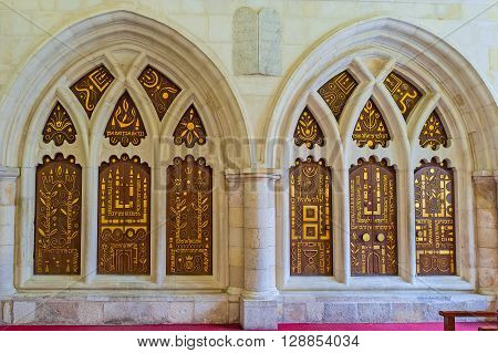 JERUSALEM ISRAEL - FEBRUARY 18 2016: The double ark in the eastern wall of the Yohanan Ben Zakkai Synagogue of Four Sephardic Synagogues complex decorated with golden patterns and inscriptions on February 18 in Jerusalem.