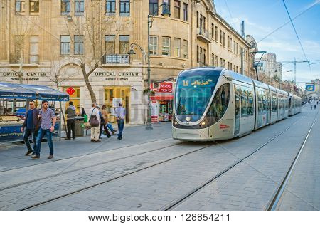 JERUSALEM ISRAEL - FEBRUARY 18 2016: The light rail train rides in Yafo Road the noisy shopping street on February 18 in Jerusalem.