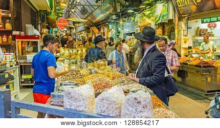 JERUSALEM ISRAEL - FEBRUARY 17 2016: The hazelnuts pistachios cashews peanuts sunflower seeds and popcorn are popular snacks in Israel on February 17 in Jerusalem.