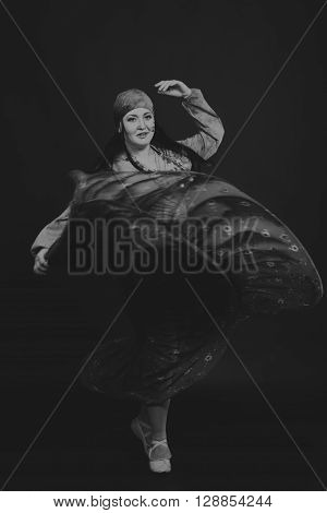 Beautiful gypsy girl on a black background black and white photo