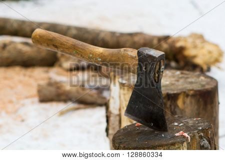 Cut log fire wood and axe . Renewable resource of a energy. Environmental concept.