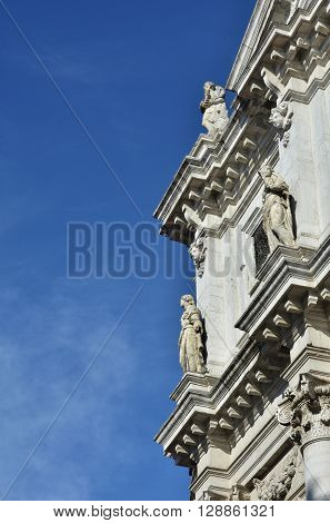 Venice church with the sky. Detail from the baroque facade of San Salvador (Holy Savior) designed by Giuseppe Sardi in 1663