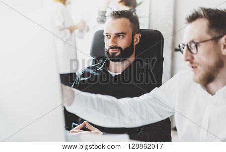 Picture of working process.Finance risk managers thinking new idea.Young business crew work with startup modern office.Desktop computer on table, showing presentation.Blurred, film effect.Horizontal.