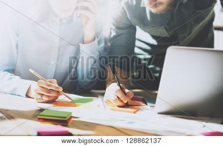 Photo team in work process, signs documents table. Account managers crew works with startup project.New idea presentation, analyze marketing plans. Blurred, film effect, horizontal.